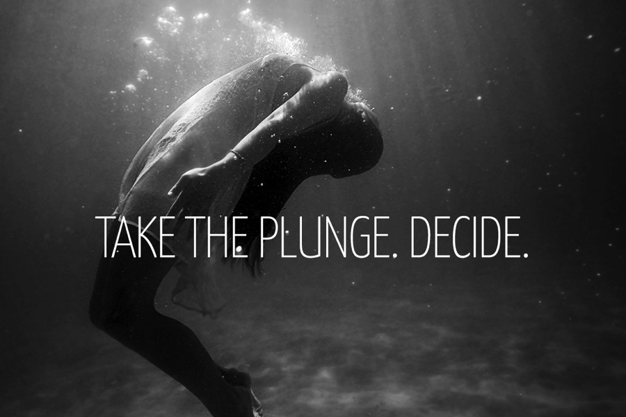 take the plunge. decide. woman in water with air bubbles