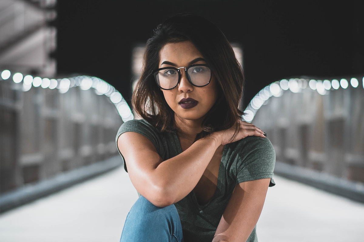 Middle Eastern woman with glasses looking determinedly at camera